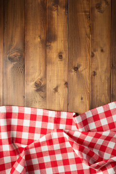 checked table cloth at wooden  background