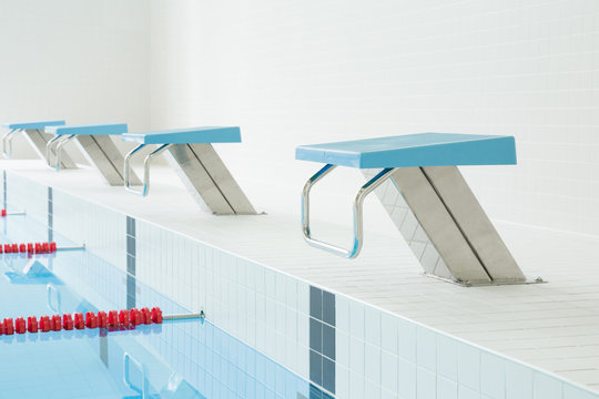 Swimming pool with starting blocks. Sport facility. Side view.
