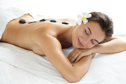 Young and beautiful woman during hot stones massage