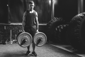 Sportsman doing farmer's walk exercise during his cross training workout