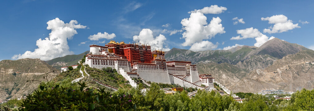 Panorama of Potala Palace, Tibet (China, Asia). Fantastic photo of the mighty palace of the Dalai Lama. Blue sky, clouds, extremly colorful. Potala Palace is an Unesco World Heritage. Located in Lhasa