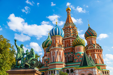 Saint Basils cathedral and monument to Minin and Pozharsky on Red Square in Moscow. Famous russian landmarks on blue sky background.