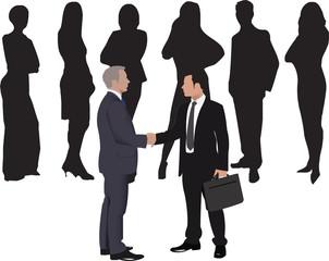 due persone si stringono le mani davanti ad un gruppo di persone
