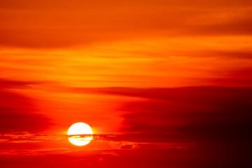 last light sunset on  sky orange cloud ray around sun