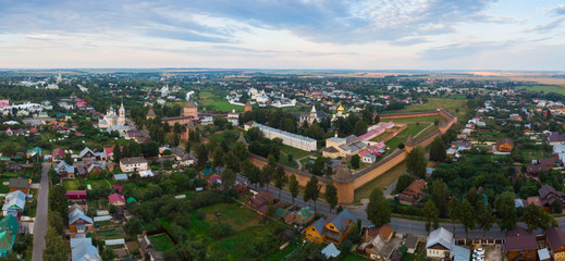 Scenic panoramic view of Suzdal, Russia. St Euthymius Monastery at the small river. Suzdal is a famous tourist attraction and part of the Golden Ring of Russia. Beautiful panorama of Suzdal in summer