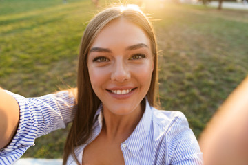 Close up of a happy young woman taking a selfie