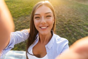 Close up of a smiling young woman taking a selfie