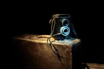 Old camera in dark background