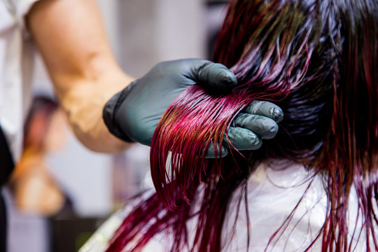 Professional hairdresser dyeing hair. Multicolor with stretching coloring