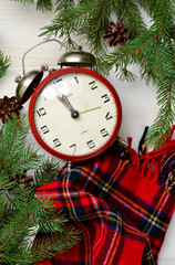 Christmas background with a clock and Christmas tree with a place for the text. Xmas greeting card.