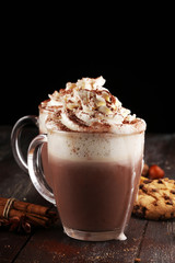Hot chocolate cocoa with whipped cream on table.