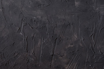Grunge stucco gray wall background or texture.