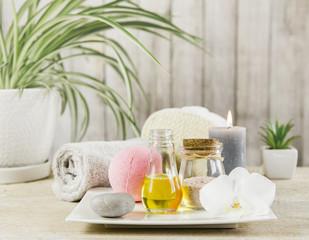 Beauty spa salon menu background minimal set. Bathroom products on light minimal wooden background. Harmonic luxury lifestyle concept. Towel, candles, bath salt, aroma massage oil in bottle.