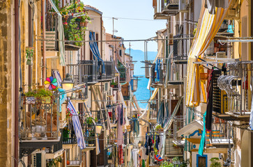 Foto auf Acrylglas Palermo A cozy street in Cefalù on a sunny summer day. Sicily, southern Italy.