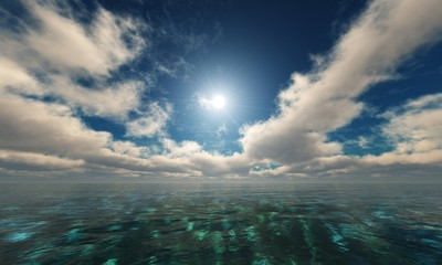 Beautiful day over the ocean. The sun in the clouds over the water.