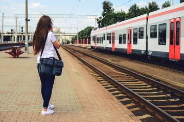 Back side of Traveller looking destination at train station, Travel and transportation concept