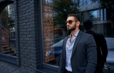 man in a business suit on the street