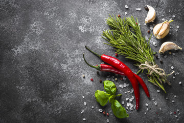 Spices and herbs over black stone table.  Fototapete