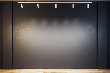 Black gallery with blank wall