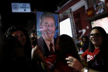 Women kiss a photograph of former Brazilian president Luiz Inacio Lula da Silva, in Fortaleza