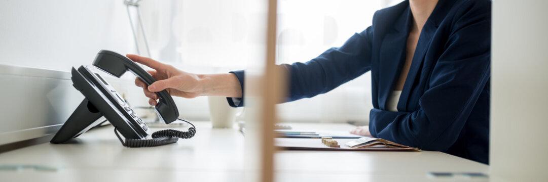 Businesswoman or picking or hanging up  handset