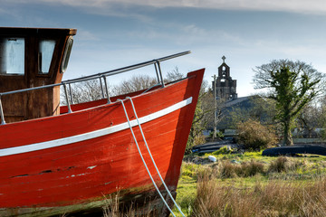 Derelict fishing boat, left to decay on the beach, Roundwood Ireland. Wooden - Red