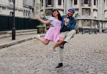 Couple dancing in Sacre Coeur of Montmartre Paris with fifties dress