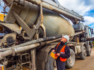 Cement unloading. Cement truck. Feed cement from mixer. Remote control cement truck.
