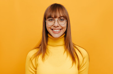2a796ae888 Woman portrait. Emotion. Beautiful young woman in eyeglasses is looking at  camera and smiling