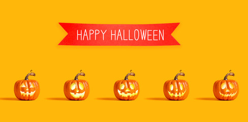 Happy Halloween message with orange pumpkin lanterns with a red banner
