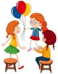 Three girls and balloons