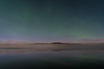 Faint northern lights above the lake