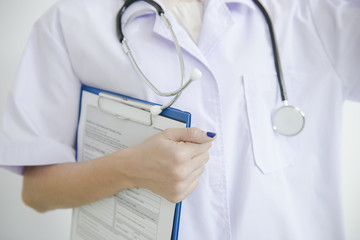 Doctors review with clipboard in hospital