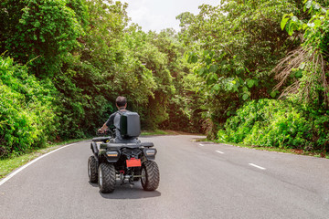 Man on atv bike adventure in forest