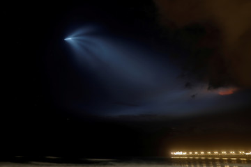 A SpaceX Falcon 9 rocket lights up the evening sky over Oceanside, California as it carries an Argentinian Earth-observing satellite into space after blasting off from Vandenberg Air Force Base