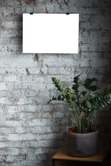 White isolated posters with frame mockup in in wall