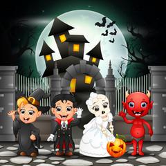 Cartoon happy kids with Halloween background