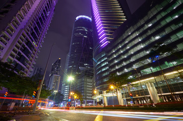 Modern building with light trails on night scene  background