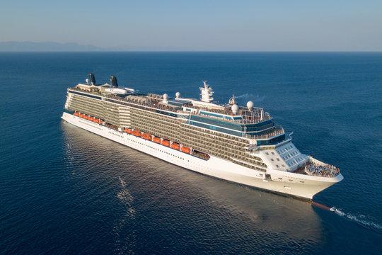 Large cruise ship at sea - Aerial image at sunrise.
