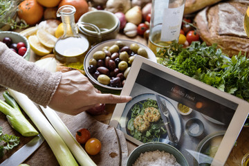 Woman reading healthy foods recipe on a tablet