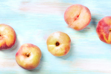 An overhead photo of vibrant organic flat saturn peaches, shot from above on a teal background with copy space