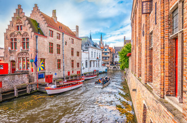 Photo sur Toile Bruges Boat trip on canal of Bruges. Popular for tourists who visit Belgium.