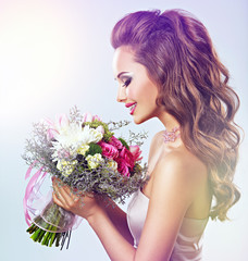 Portrait of beautiful girl with flowers in hands
