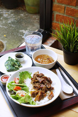 Simple lunch set with streamed pork with spring roll and soup.