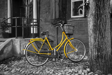 Yellow bike on B/W back