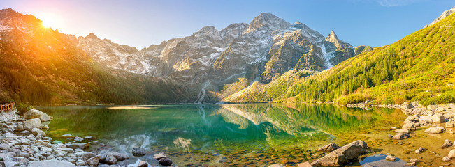 Tuinposter Bergen Tatra National Park, a lake in the mountains at the dawn of the sun. Poland
