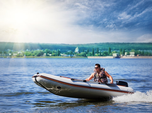 Inflatable white motor boat