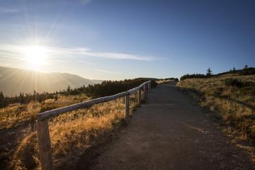 Beautiful colorful hiking road path at Krkonoše mountain national park at sunrise at sunset
