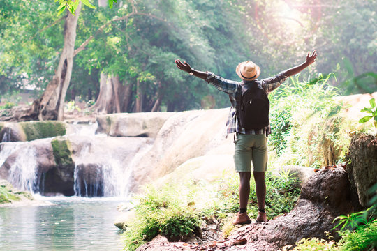 African Man Traveller with backpack standing and relaxing  with freedom and happy