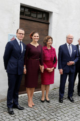 Sweden's Crown Princess Victoria and Prince Daniel, Sweden's King Carl XVI Gustaf and Queen Silvia pose in front of the Bernadotte Museum in Pau